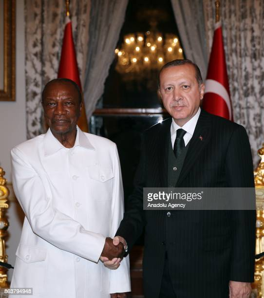 President of Turkey Recep Tayyip Erdogan shakes hands with President of Guinea Alpha Conde as they pose for a photo in Istanbul Turkey on October 20...