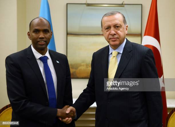 President of Turkey Recep Tayyip Erdogan shakes hands with Prime Minister Hassan Ali Khayre within the 72nd Session of the UN General Assembly in New...