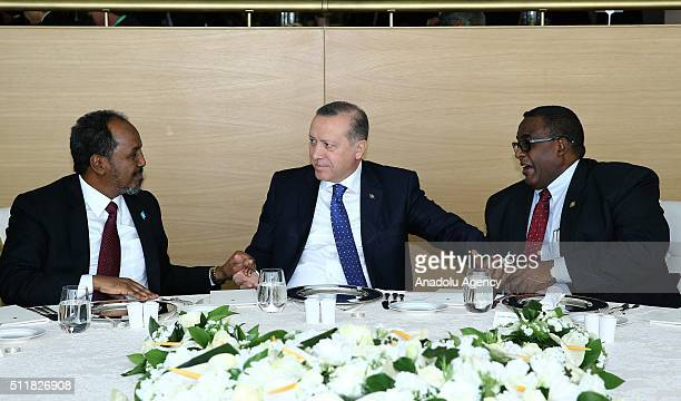 President of Turkey Recep Tayyip Erdogan speaks with President of Somalia Hassan Sheikh Mohamoud during luncheon after 'High Level Partnership Forum...