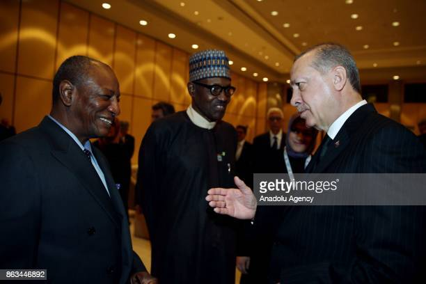 President of Turkey Recep Tayyip Erdogan speaks with the President of Nigeria Muhammed Buhari and President of Guinea Alpha Conde during the 9th D8...