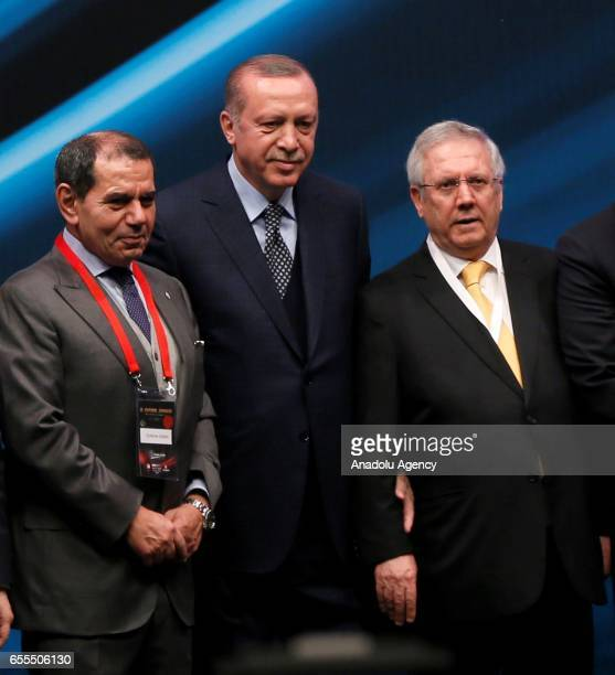 President of Turkey Recep Tayyip Erdogan stands next to Chairman of Fenerbahce Aziz Yildirim and Galatasaray Sports Club President Dursun Ozbek as...