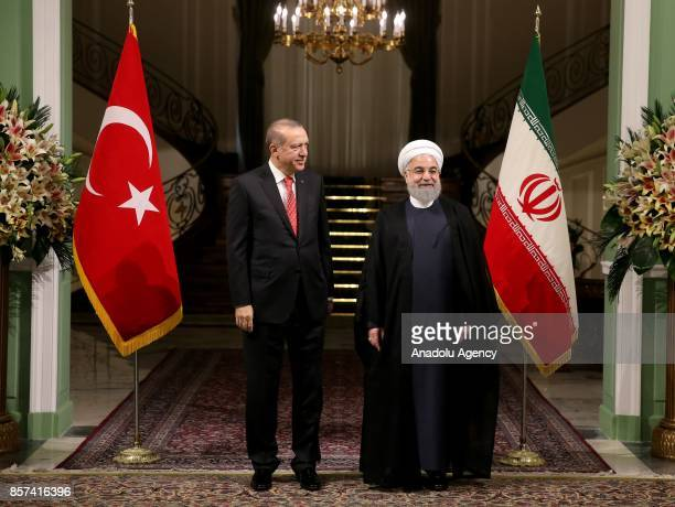 President of Turkey Recep Tayyip Erdogan stands next to Iranian President Hassan Rouhani during an official welcoming ceremony at the Saadabad Palace...