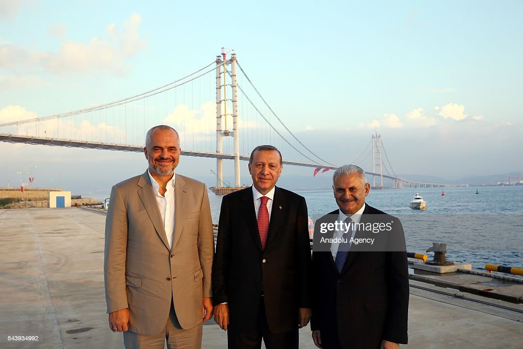 President of Turkey, Recep Tayyip Erdogan (C), Turkish Prime Minister Binali Yildirim (R) and Albanian Prime Minister Edi Rama (L) attend the opening ceremony of Osmangazi Bridge in Kocaeli, Turkey on June 30, 2016. Osmangazi Bridge is the fourth-longest suspension bridge in the world and second-longest bridge in Europe.