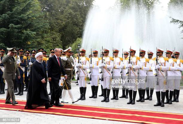 President of Turkey Recep Tayyip Erdogan walks past the honour guards with Iranian President Hassan Rouhani during an official welcoming ceremony at...