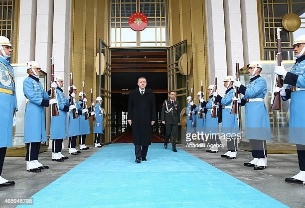 President of Turkey Recep Tayyip Erdogan walks to welcome Amir of Qatar Sheikh Tamim bin Hamad al Thani at the presidential palace in Ankara Turkey...