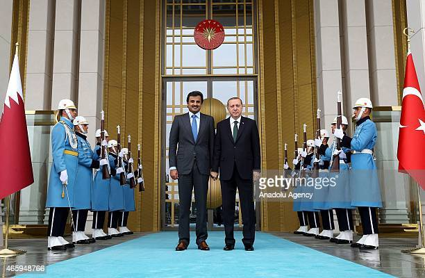 President of Turkey Recep Tayyip Erdogan welcomes Amir of Qatar Sheikh Tamim bin Hamad al Thani at the presidential palace in Ankara Turkey on March...