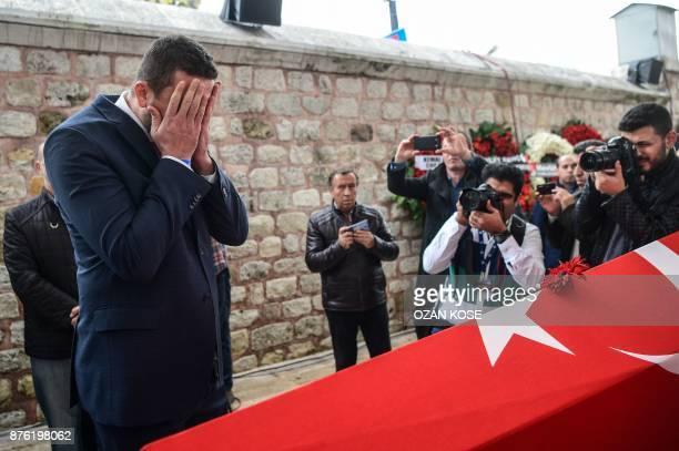 President of Turkish Basketball Federation Hidayet Turkoglu prays next to the coffin of Turkey's legendary triple Olympic goldmedal winning...