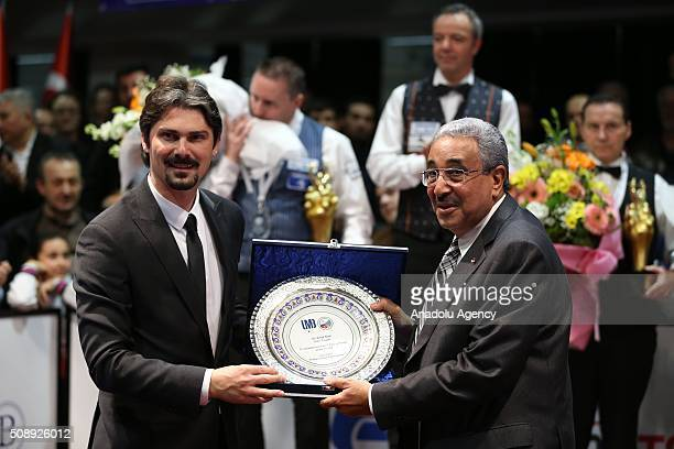 President of Turkish Billiards Federation Ersan Ercan gives a plaquet to President of the Union Mondiale de Billard UMB Farouk Barki after the final...
