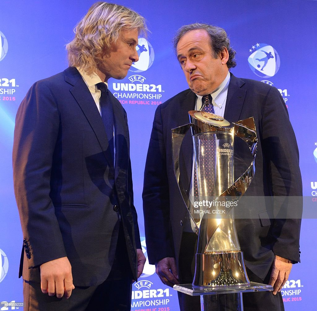 President of UEFA Michel Platini R and Pavel Nedved former