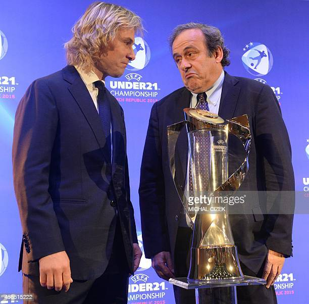 President of UEFA Michel Platini and Pavel Nedved former Czech football player and former player of Juventus FC pose for photographers after the draw...