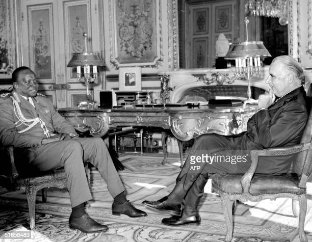 President of Uganda Idi Amin Dada faces 16 September 1971 at the ElysTe Palace in Paris French President Georges Pompidou during his visit to France...