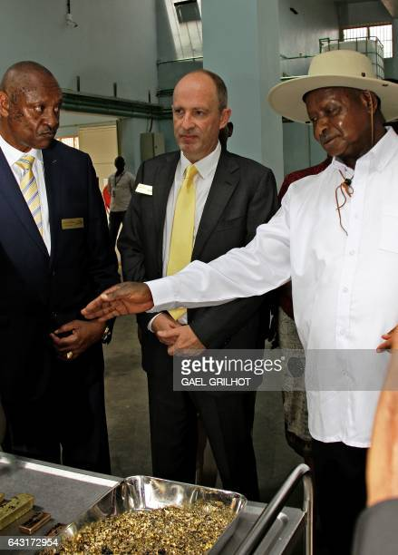 President of Uganda Yoweri Museveni and Alain Goetz CEO of AGR Limited are shown gold flakes at the African Gold Refinery in Entebbe on February 20...