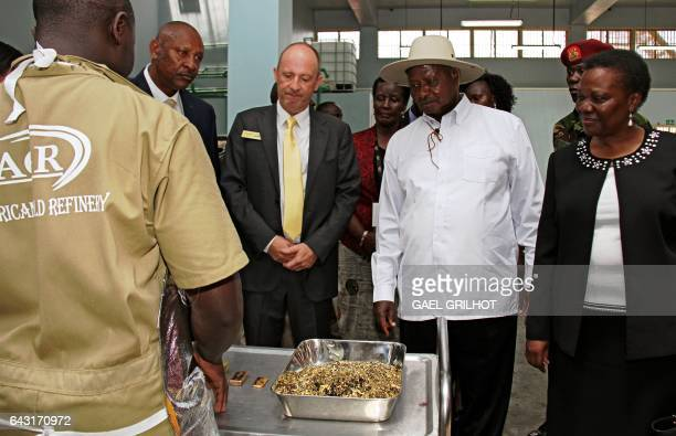 President of Uganda Yoweri Museveni flanked by Irene Muloni Minister of Energy and Minerals Development and Alain Goetz CEO of AGR Limited is shown...