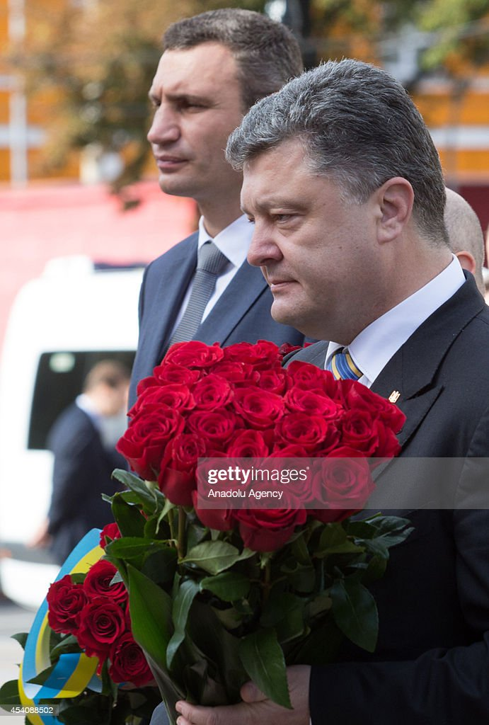 President of Ukraine Petro Poroshenko (on the photo) visits monuments of crucial people of Ukraine's history and EuroMaidan where people died during the unrest and put flowers on February and puts flowers on the monuments, on 23rd anniversary of Ukraine's Independence Day in Kiev, Ukraine on 24 August, 2014.