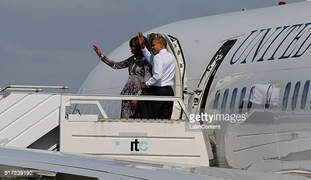 President of US Barack Obama and his wife Michelle Obama greet before leaving at Ministro Pistarini International Airport on March 24 2016 in Buenos...