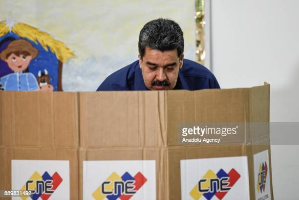 President of Venezuela Nicolas Maduro casts his vote at a polling station during municipal election in Caracas Venezuela on December 10 2017