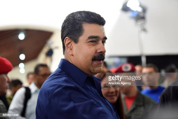 President of Venezuela Nicolas Maduro greets people after casting his vote at a polling station during municipal election in Caracas Venezuela on...