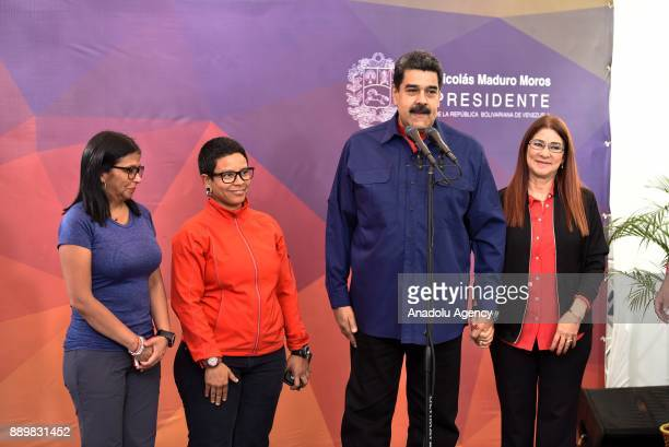 President of Venezuela Nicolas Maduro makes a speech during a press conference as he is flanked by his wife First Lady Cilia Flores Venezuela's...