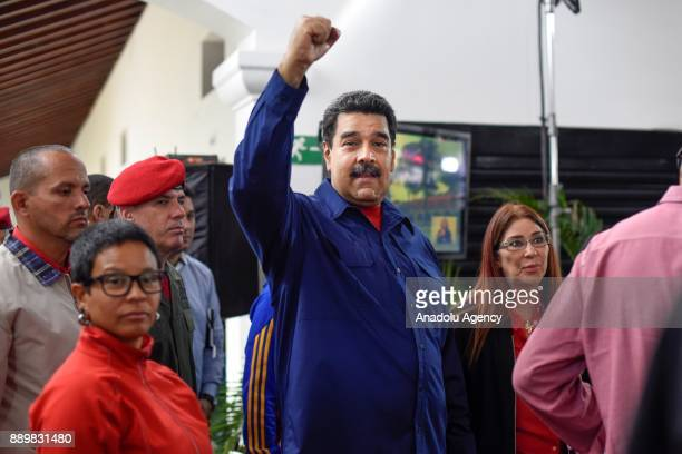 President of Venezuela Nicolas Maduro poses for a photo after casting his vote at a polling station during municipal election in Caracas Venezuela on...