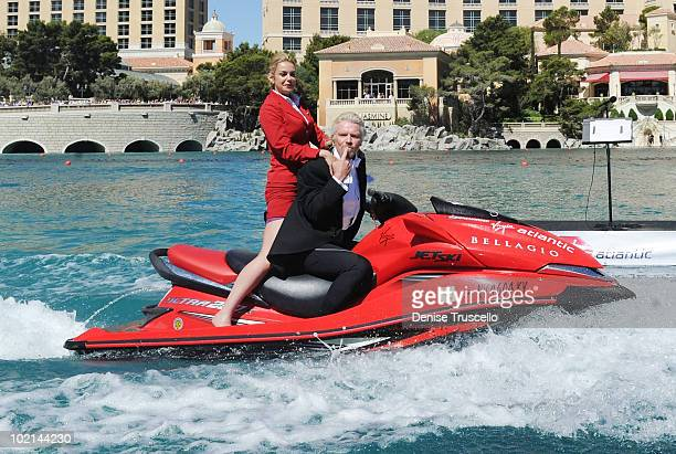 President of Virgin Atlantic Richard Branson and Virgin Airlines cabin attendant Vicky Lewis ride a jet ski in the Bellagio fountains at the Bellagio...