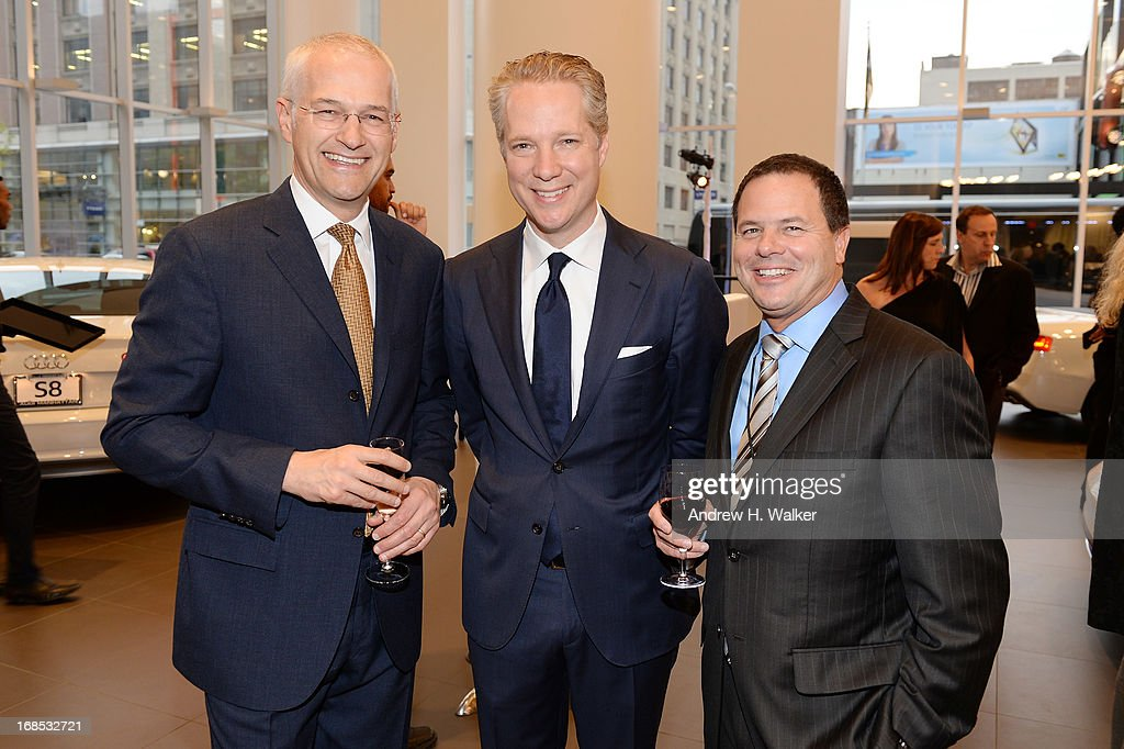 President of Volkswagen Group of America Jonathan Browning, President of Audi of America Scott Keogh, and guest attend the grand opening of the Audi and Volkswagen Manhattan dealership on May 10, 2013 in New York City.