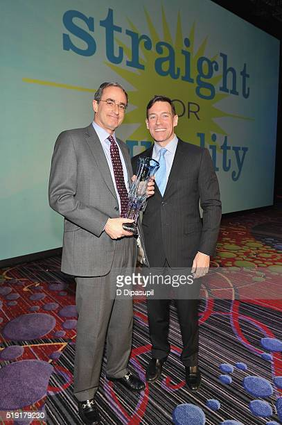 President of Wells Fargo Securities Jon Weiss and chief marketing officer at RitzCarlton Ed French pose with an award at PFLAG National's eighth...