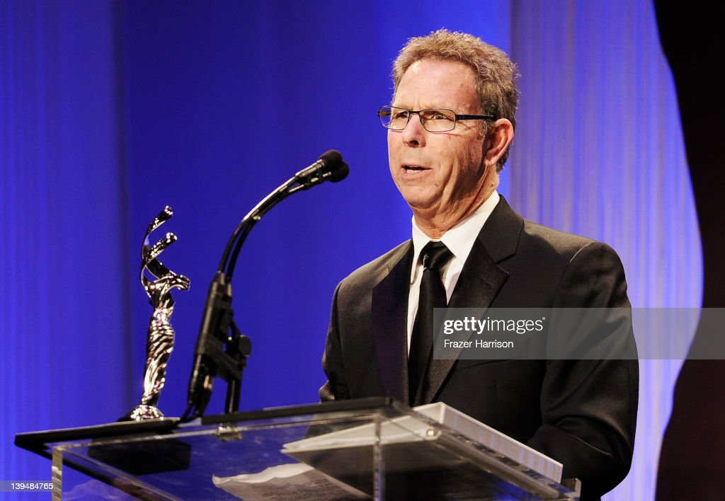 President of Western Costume Eddie Marks accepts the Service Award onstage during the 14th Annual Costume Designers Guild Awards With Presenting Sponsor Lacoste held at The Beverly Hilton hotel on February 21, 2012 in Beverly Hills, California.