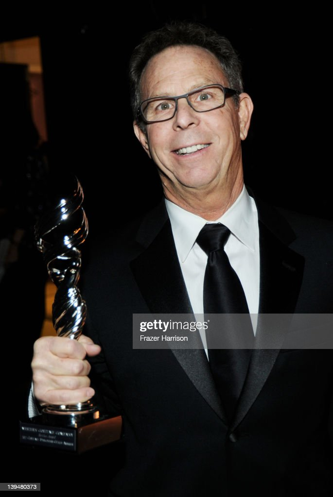 President of Western Costume Eddie Marks poses with the Service Award during the 14th Annual Costume Designers Guild Awards With Presenting Sponsor Lacoste held at The Beverly Hilton hotel on February 21, 2012 in Beverly Hills, California.