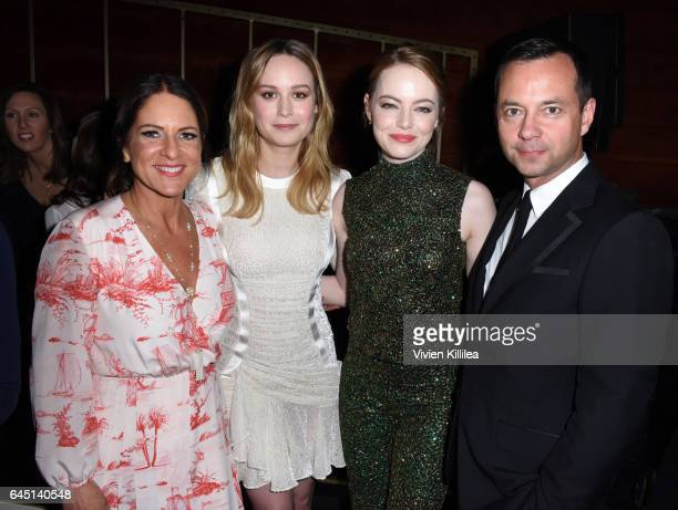President of Women In Film Cathy Schulman actors Brie Larson Emma Stone and Laurent Claquin attend the tenth annual Women in Film PreOscar Cocktail...