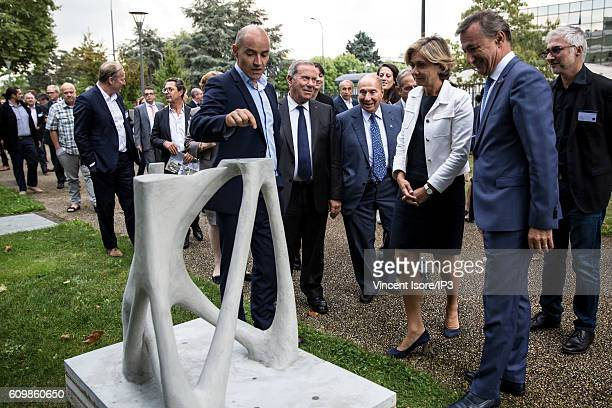 President of XtreeE a Parisian startup Philippe Morel explains the concept of 3D printing to Managing Director of Marcel Dassault Group Charles...