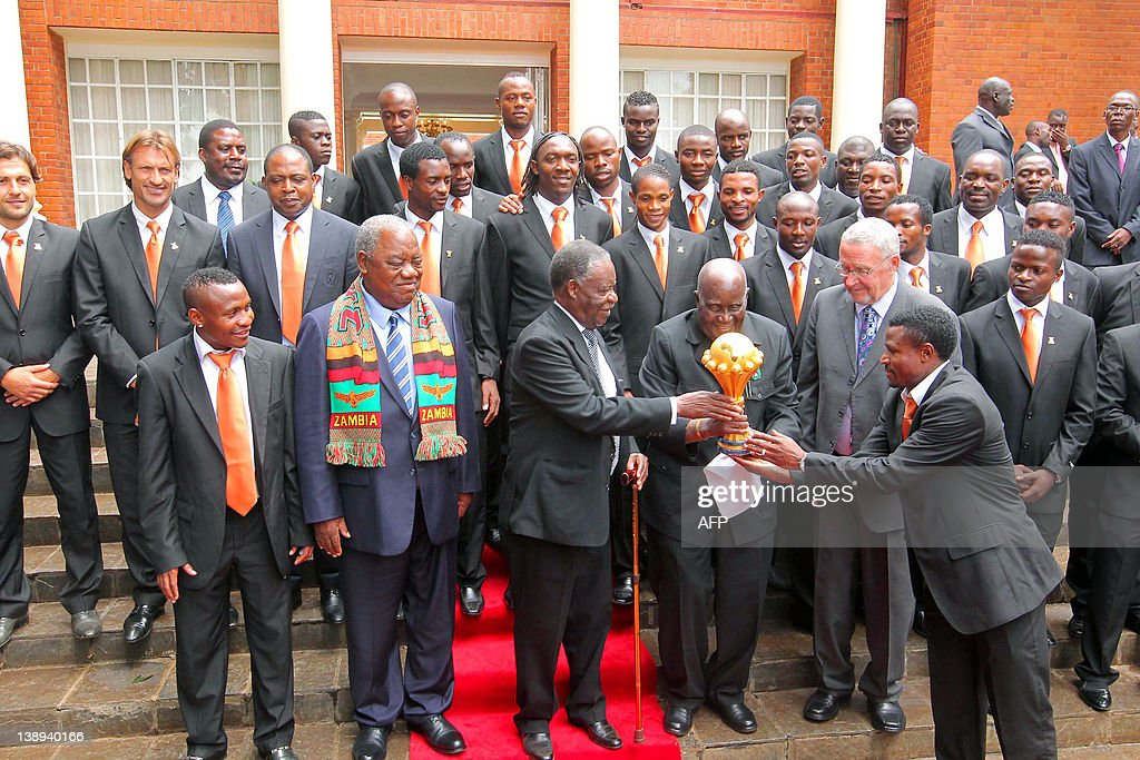 President of Zambia Michael Sata and national football team captain Christopher Katongo hand the AFCON trophy to the first republican president...