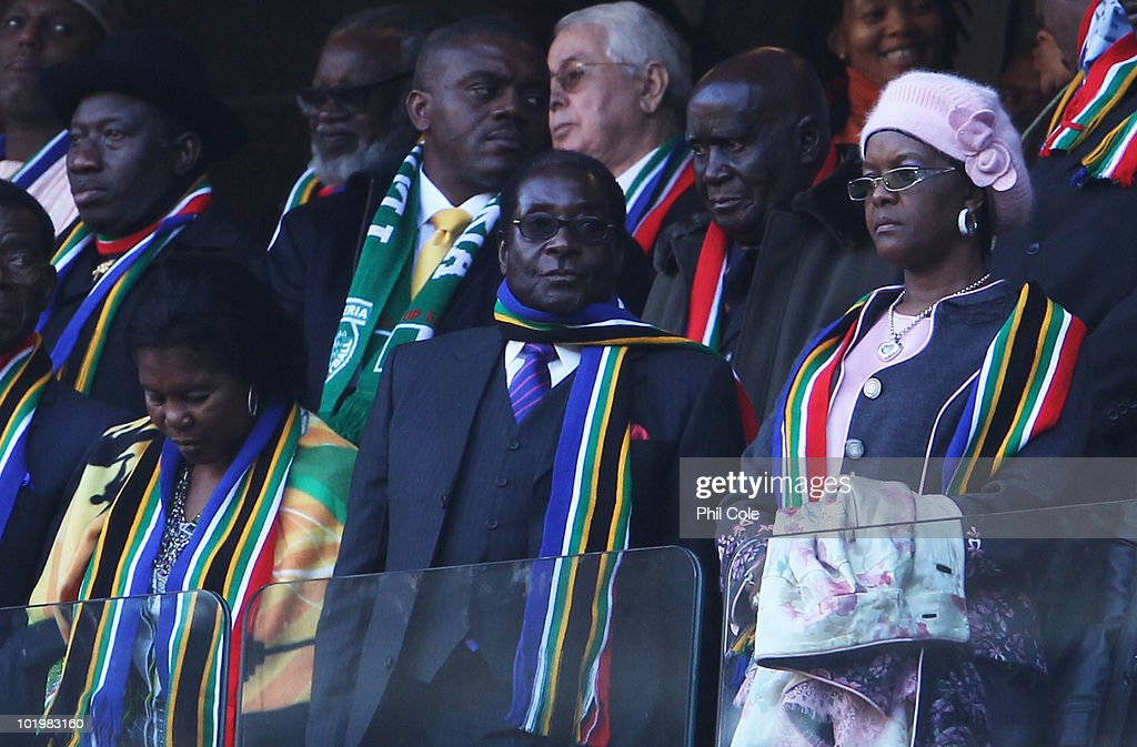 President of Zimbabwe <a gi-track='captionPersonalityLinkClicked' href=/galleries/search?phrase=Robert+Mugabe&family=editorial&specificpeople=214676 ng-click='$event.stopPropagation()'>Robert Mugabe</a> (C) attends the 2010 FIFA World Cup South Africa Group A match between South Africa and Mexico at Soccer City Stadium on June 11, 2010 in Johannesburg, South Africa.