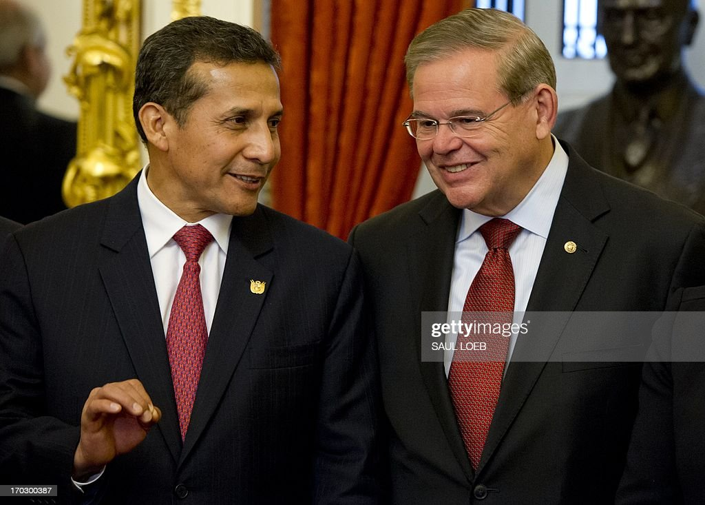 President Ollanta Humala (L) of Peru confers with Senate Foreign Relations Committee Chairman Robert Menendez (R), D-NJ, prior to a meeting at the US Capitol in Washington, DC, June 10, 2013. AFP PHOTO / Saul LOEB