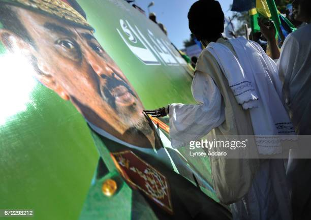 President Omar alBashir addresses tens of thousands of supporters at a rally in downtown Khartoum the day after being issued a warrant for his arrest...