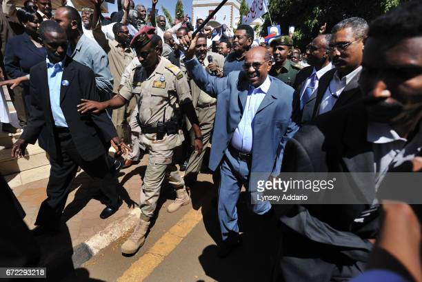 President Omar alBashir enters a rally where he addressed tens of thousands of supporters at a rally in downtown Khartoum the day after being issued...