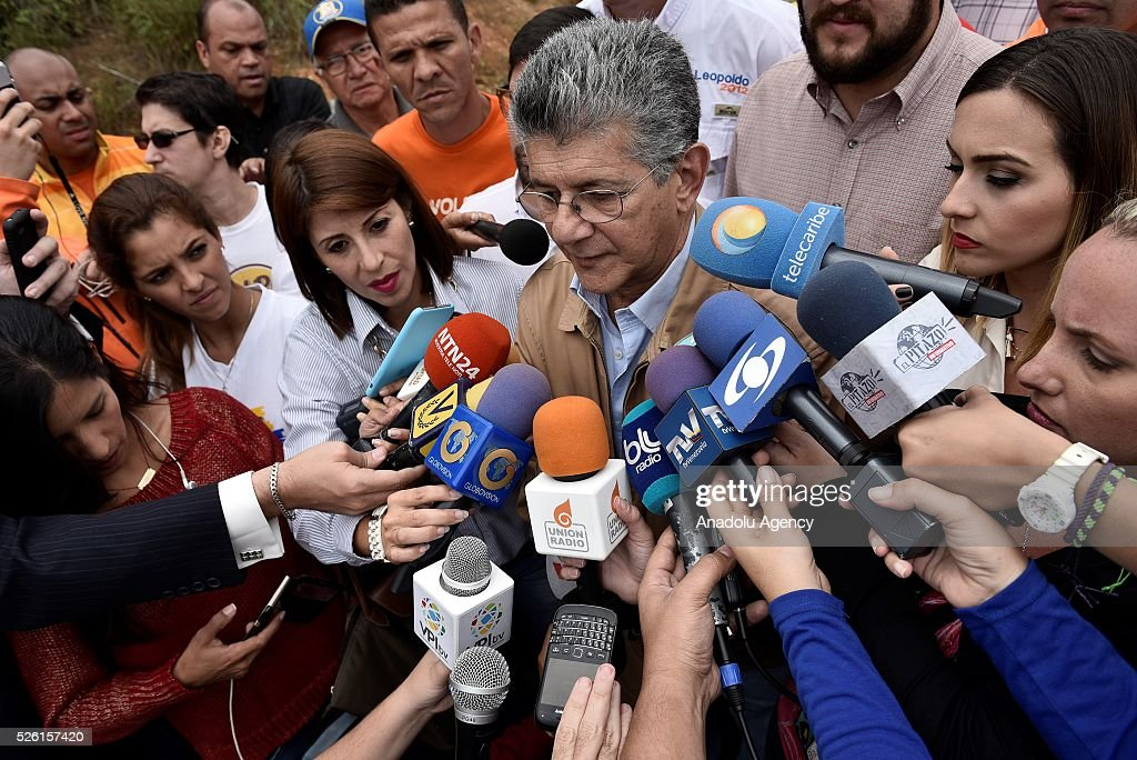 President on National Assembly Henry Ramos Allup (C) address to the press outside Ramo Verde Prision after unsuccssesfully attempt to visit jailed opposition Leader Leopoldo Lopez on his 45th Birthday in Los Teques, Venezuela on April 29, 2016.