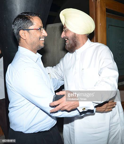 PPCC president Partap Singh Bajwa talking with BJP leader Anil Joshi before assembly session at Punjab Vidhan Sabha on July 21 2014 in Chandigarh...