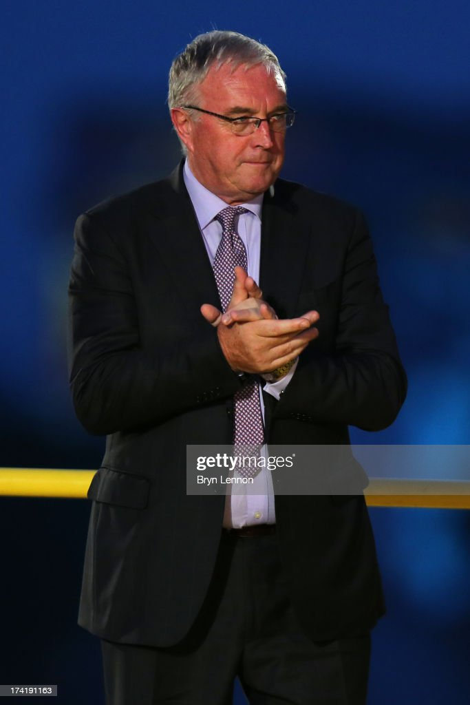 President <a gi-track='captionPersonalityLinkClicked' href=/galleries/search?phrase=Pat+McQuaid&family=editorial&specificpeople=873831 ng-click='$event.stopPropagation()'>Pat McQuaid</a> appears on the podium after the twenty first and final stage of the 2013 Tour de France, a processional 133.5KM road stage ending in an evening race around the Champs-Elysees, on July 21, 2013 in Paris, France.