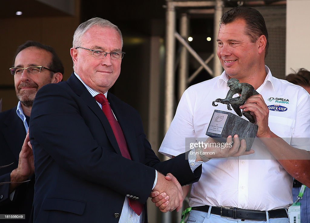 UCI President <a gi-track='captionPersonalityLinkClicked' href=/galleries/search?phrase=Pat+McQuaid&family=editorial&specificpeople=873831 ng-click='$event.stopPropagation()'>Pat McQuaid</a> (l) presents Omega Pharma - Quick Step Directeur Sportif Wilfried Peeters with the winner's trophy after during the Elite Men's Team Time Trial on day one of the UCI Road World Championships on September 22, 2013 in Poggio a Calano, Italy.