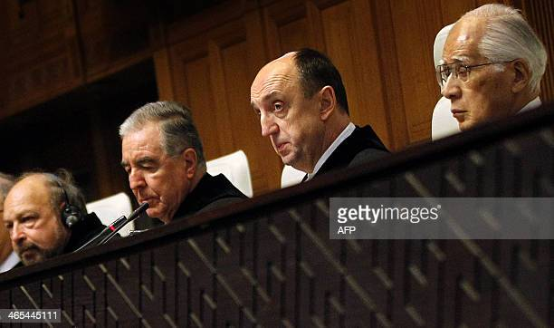 President Peter Tomka of Slovakia Judge Hisashi Owada from Japan and Vice President Bernado SetulvedaAmor of Mexico listen at the International Court...