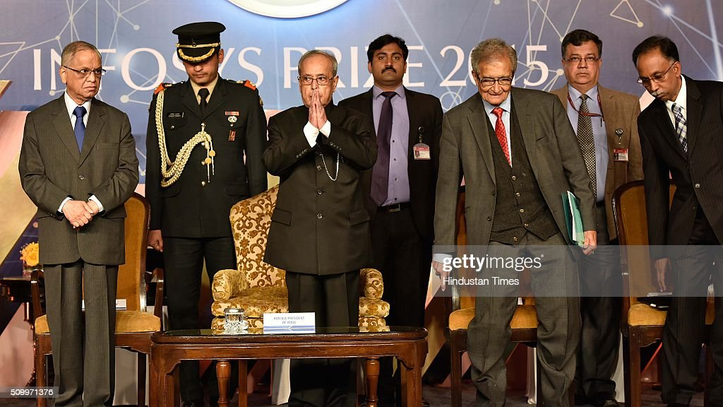 President Pranab Mukherjee along with N. R. Narayana Murthy (co-founder of Infosys), Amartya Sen, Economist, stand for the National Anthem during the Infosys Award 2015 organized by infosys Science Foundation at Taj Place on February 13, 2016 in New Delhi, India. President felicitated six winners of Infosys Science Foundation Prizes 2015 for their outstanding contribution in their fields. President awarded each laureate with a purse of Rs.65 lakh, a 22-carat gold medallion and a citation certificate.