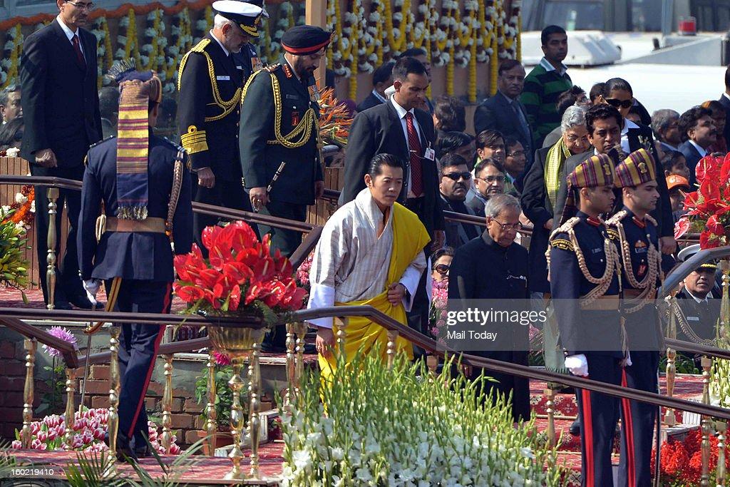 President Pranab Mukherjee and chief guest King of Bhutan, Jigme Khesar Namgyel Wangchuck during 64th Republic Day celebrations in New Delhi on Saturday.