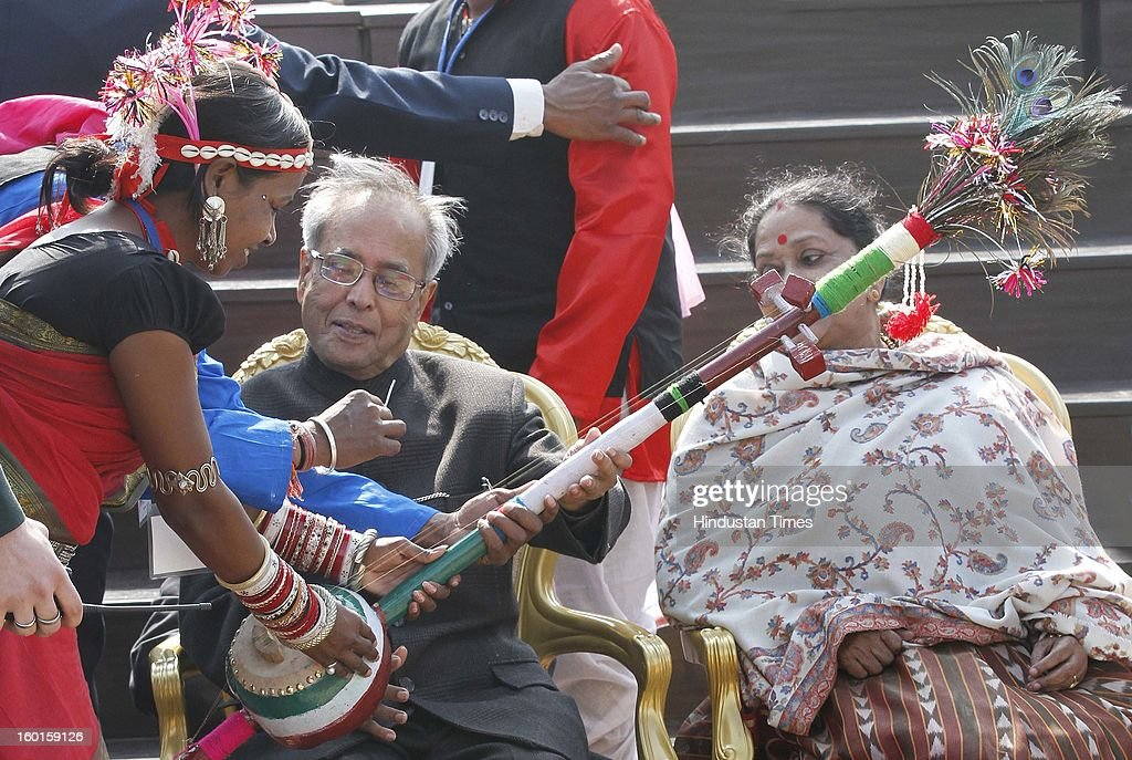 President Pranab Mukherjee and his wife <a gi-track='captionPersonalityLinkClicked' href=/galleries/search?phrase=Suvra+Mukherjee&family=editorial&specificpeople=10170312 ng-click='$event.stopPropagation()'>Suvra Mukherjee</a> (R) and artists who participated in the Republic Day Parade-2013 at Rashtrapati Bhavan on January 27, 2013 in New Delhi, India.