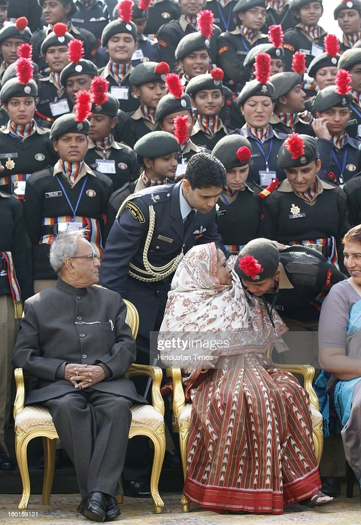 President Pranab Mukherjee and his wife <a gi-track='captionPersonalityLinkClicked' href=/galleries/search?phrase=Suvra+Mukherjee&family=editorial&specificpeople=10170312 ng-click='$event.stopPropagation()'>Suvra Mukherjee</a> (R) and NCC Cadets who participated in the Republic Day Parade-2013 at Rashtrapati Bhavan on January 27, 2013 in New Delhi, India.