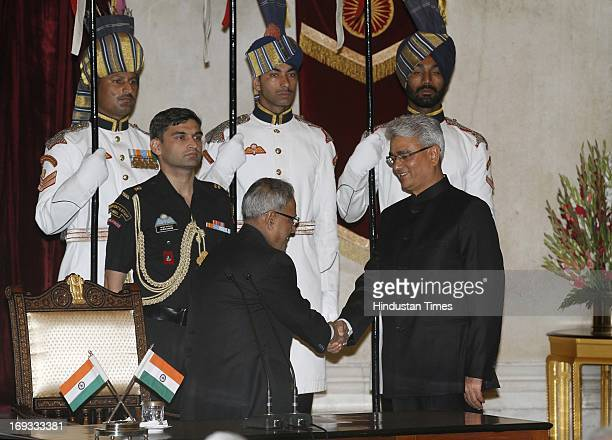 President Pranab Mukherjee greets Shashi Kant Sharma after he took oath as Comptroller and Auditor General of India at a ceremony at Rashtrapati...