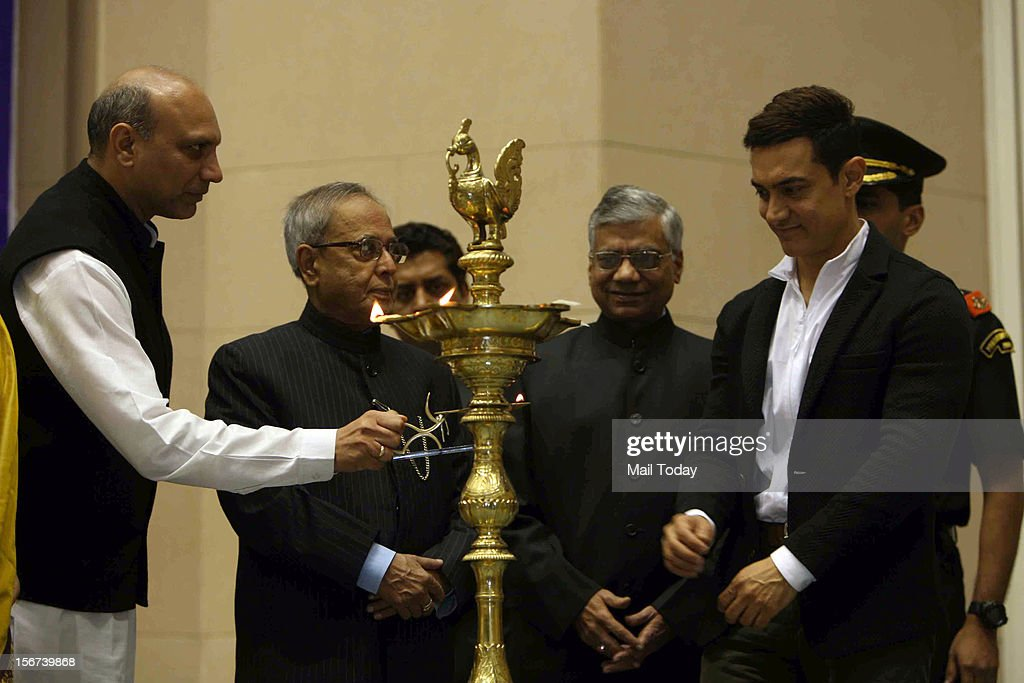 President Pranab Mukherjee, HRD minister MM Pallam Raju, minister for women child development Krishna Tirath and actor Aamir Khan lighting a lamp during the launch of IEC campaign against Malnutrition, in New Delhi on Monday.