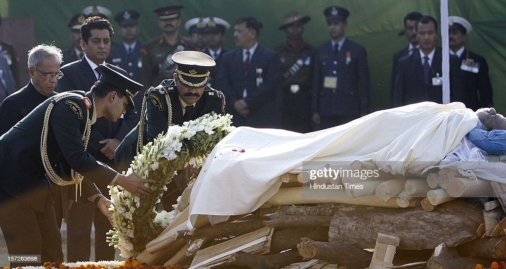 President Pranab Mukherjee laying wreath on the pyre of former Prime Minister of India Inder Kumar Gujral during his funeral on December 1, 2012 in New Delhi, India. Inder Kumar Gujral who served as 12th Prime minister of India from April 1997 to March 1998 passed away on November 30, 2012 at the age of 92 years.