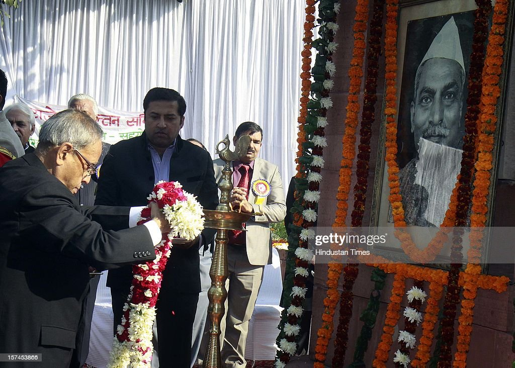 President Pranab Mukherjee paying floral tributes at the portrait of the Indian First President of India, Late Dr. Rajendra Prasad on the occasion of his 128th birth anniversary on December 3, 2012 in New Delhi, India.