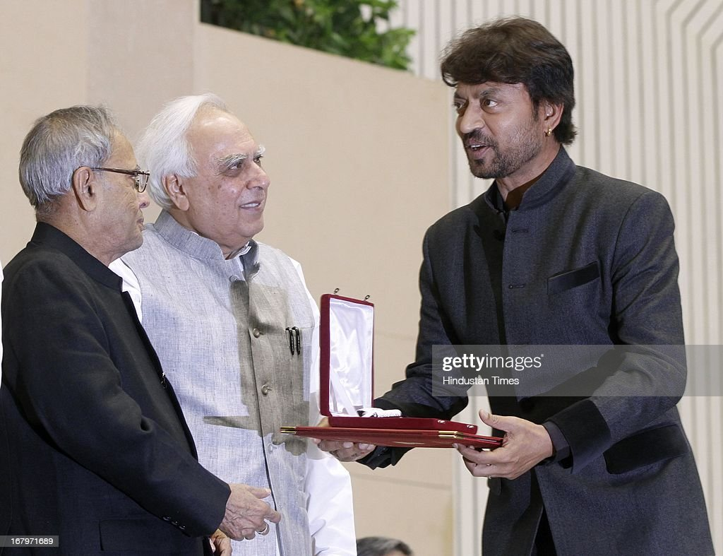 President Pranab Mukherjee presenting best actor award to Irfan Khan at 60th National Film Awards on May 03, 2013 in New Delhi , India. Paan Singh Tomar' got best film award and its lead actor Irrfan Khan adjudged as the best actor.