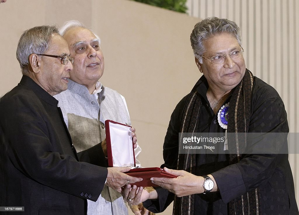 President Pranab Mukherjee presenting best actor award to Vikram Gokhale for performance in Marathi film Anumati during 60th National Film Awards on May 03, 2013 in New Delhi , India. Paan Singh Tomar' got best film award and its lead actor Irrfan Khan adjudged as the best actor.